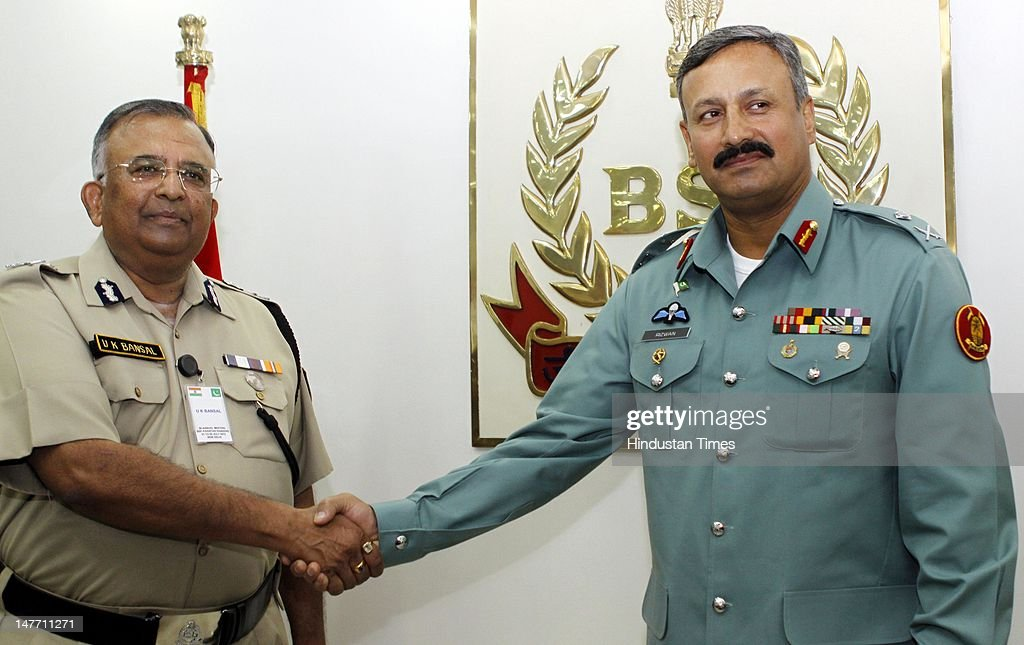 Border Security Force Director General U. K. Bansal (L) shaking hand with Director General of Pakistani Rangers (Sindh) Major General Rizwan Akhtar (R) during BSF-Pakistan Rangers bi-annual meeting 2012 on July 2, 2012 in New Delhi, India. Maj Gen Rizwan Akhtar is leading 18-member high-level delegation of Pakistan Rangers and Interior Ministry on 5-day border level talks with BSF.