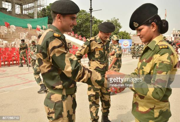 Border Security Force females tying rakhi to their male colleagues' wrists on the occasion of Raksha Bandhan festival at Attar Border near on August...