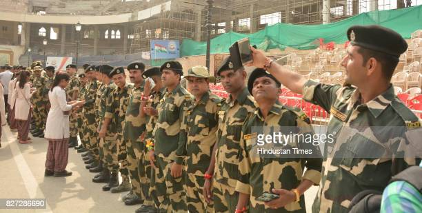 Border Security Force Jawans showing their rakhi on the occasion of Raksha Bandhan festival at Attar Border near on August 7 2017 in Amritsar India...