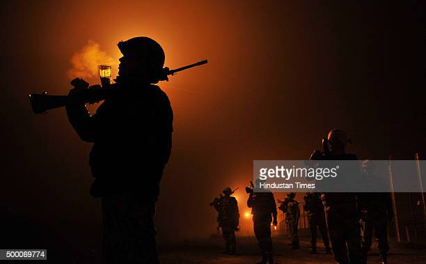 BSF Patrol At IndiaPakistan Border In Jammu Border Security Force personnel patrolling in a foggy winter night at International border on December 5...