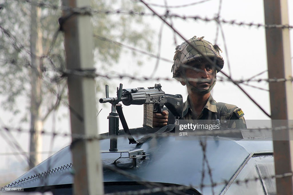 A Border Security Force (BSF) soldier patrols on a vehicle at the India-Pakistan international border at Suchetgarh, some 32 kilometers (20 miles) from the winter state capital Jammu on January 9, 2013. India summoned Pakistan's envoy in New Delhi Wednesday to protest the killing of two soldiers in a border clash, but warned against any escalation, after apparent tit-for-tat skirmishes that have led to deaths on both sides. Two Indian soldiers died after a firefight erupted in disputed Kashmir on Tuesday as a patrol moving in fog discovered Pakistani troops about 500 metres (yards) inside Indian territory, according to the Indian army. AFP PHOTO