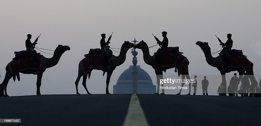 Border Security Force (BSF) soldiers ride their camels in front of India's presidential palace Rashtrapati Bhavan during a rehearsal for the 'Beating the Retreat' ceremony at Raisina Hills on January 24, 2013 in New Delhi, India. The ceremony symbolises retreat after a day on the battlefield, and marks the official end of the Indian Republic Day celebrations. It is held every year on January 29.
