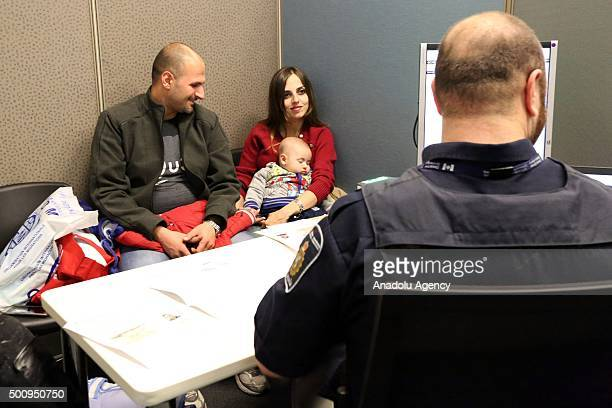Border Services Officer Hyde processes a Syrian refugee family at Toronto Pearson International Airport on December 11 2015