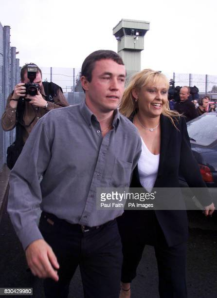 Border sniper gang member Michael Caraher walks free from the Maze prison after being greeted by a lady friend There were smiles and cheers all round...