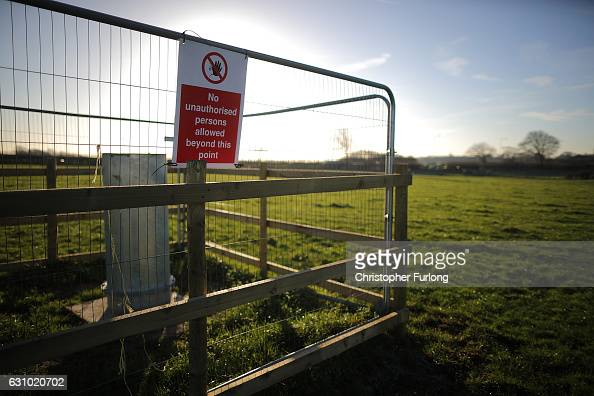 A bore hole to measure the ground water table is fenced off as workmen begin the construction of the shale gas fracking site near Westby on January 5...