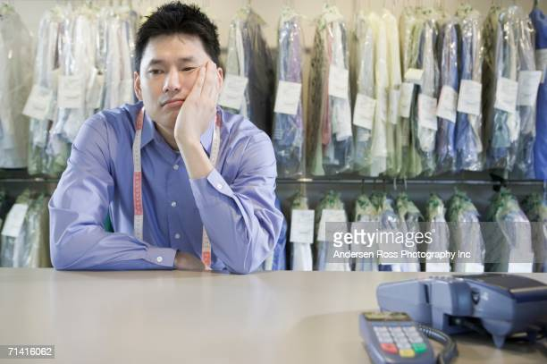 Bored Asian drycleaner