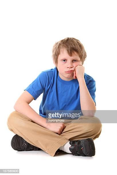 Gelangweilt junge sitzt