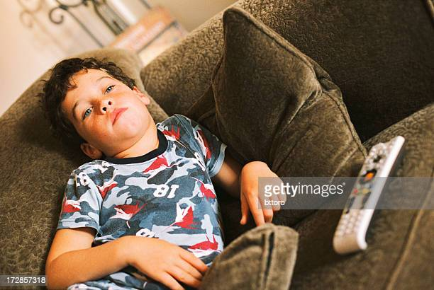 Bored Boy with TV Remote on Couch