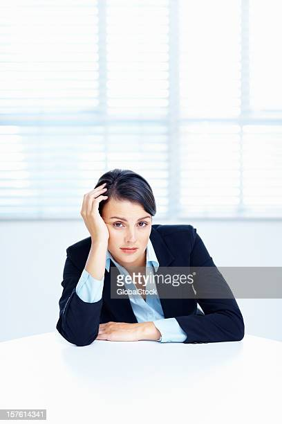 Bored business woman sitting at a table