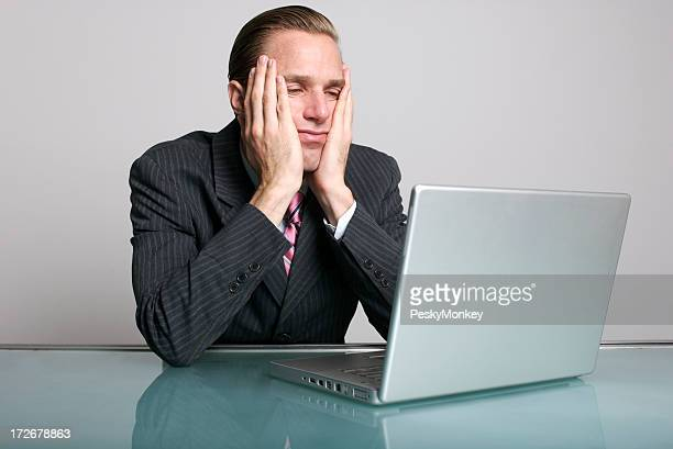 Bored Businessman Looking Tired of Waiting at Desk Laptop