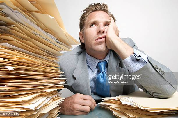 Bored Businessman Office Worker Looking at Stack of Paperwork Inbox