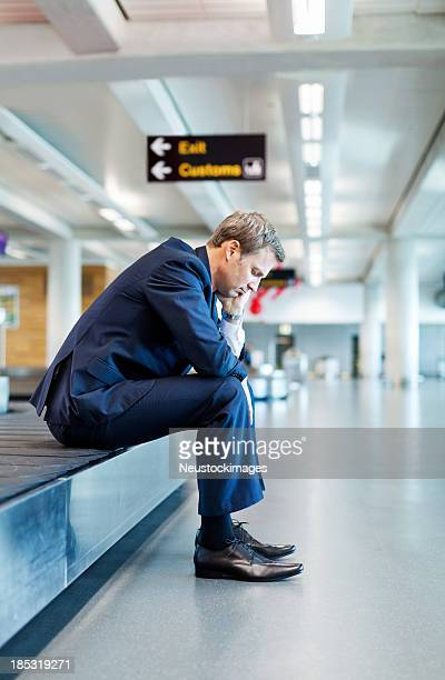 Bored Businessman Sitting On Conveyor Belt