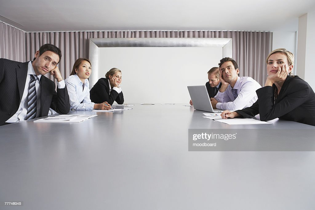 Bored Businesspeople Sitting in Conference Room : Stock Photo