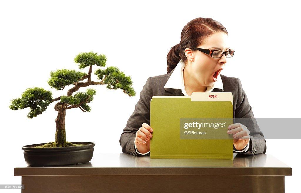 Bored businesswoman yawning : Stock Photo