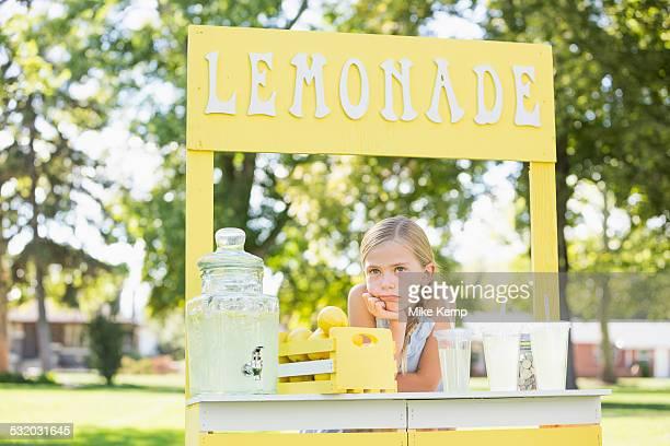 Bored Caucasian girl at lemonade stand
