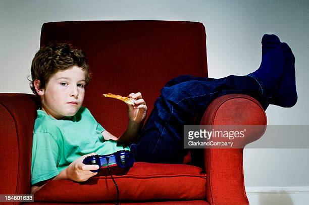 Bored Couch Potato Boy Eating Junk Food