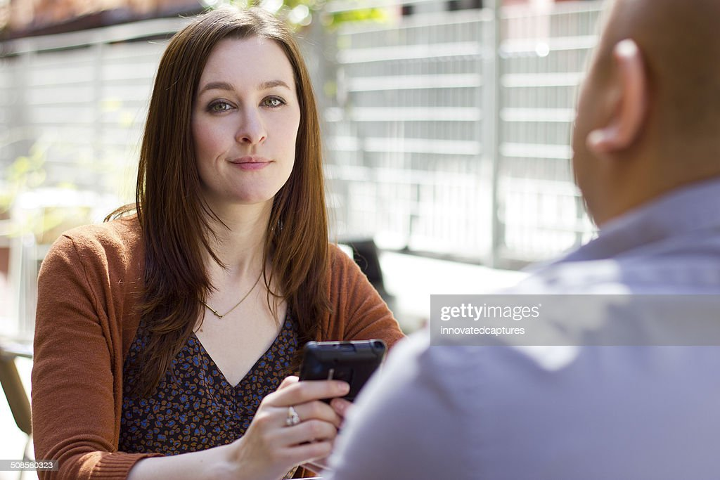Bored Female on an Outdoor Date is Distracted by Phone : Stockfoto