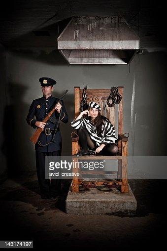 Bored Female Prisoner In Electric Chair Stock Photo ...