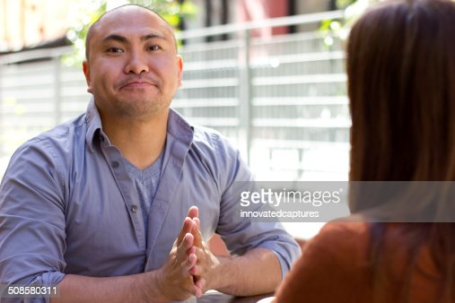 Bored Man on a Date Showing Disappointment : Stock Photo