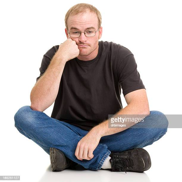 Bored Man Sitting With Legs Crossed