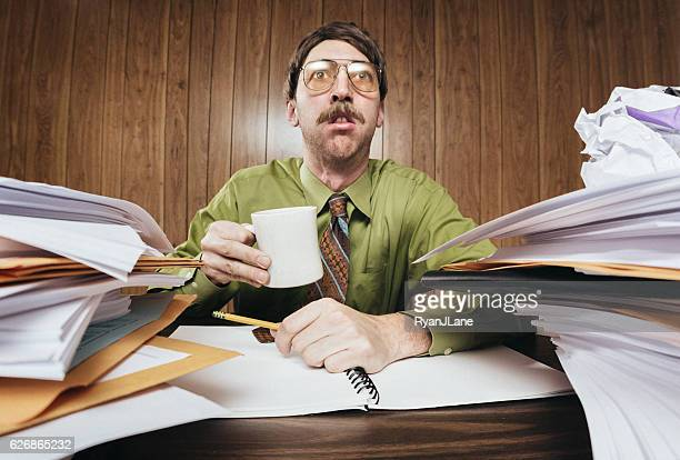 Bored Office Worker with Cluttered Desk