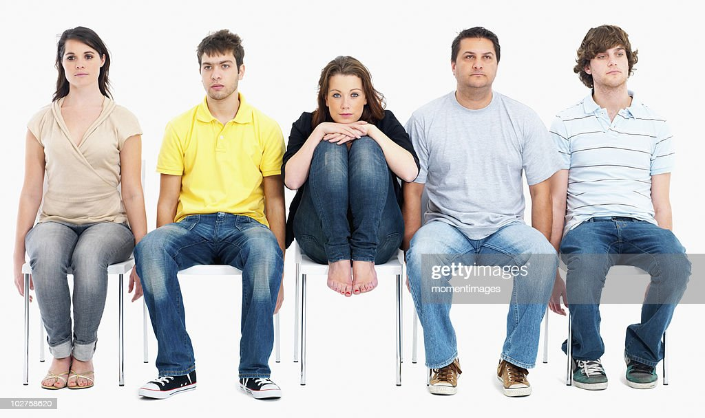 Bored people sitting on chairs