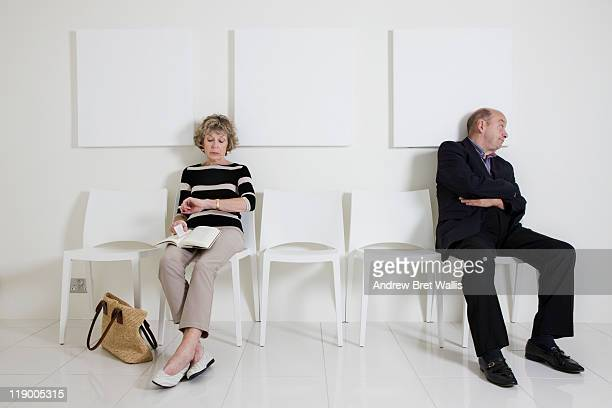 Bored senior man & woman in a waiting room