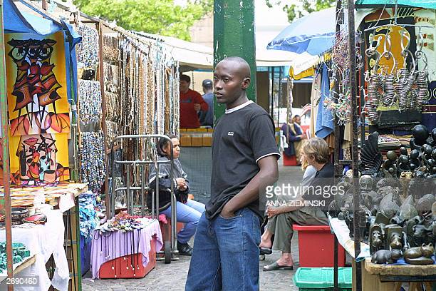 TOURISM Bored traders languish on Greenmarket Square in central Cape Town 30 October 2003 The market which caters mainly for foreign tourists is...
