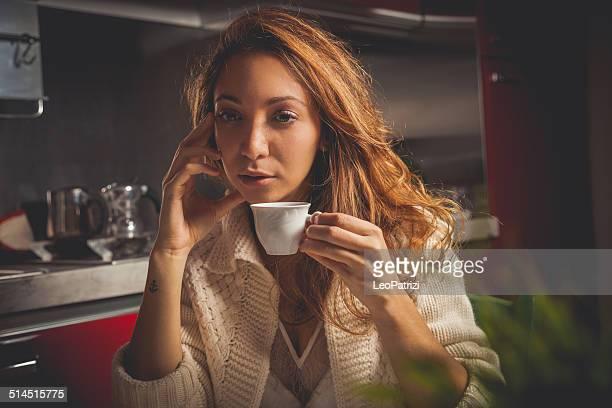 Bored woman having breakfast