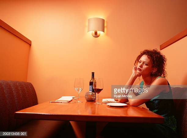 Bored woman waiting at table in restaurant