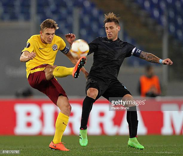 Borek Dockal of Sparta Prague competes for the ball with Lucas Biglia of SS Lazio during the UEFA Europa League Round of 16 second leg match between...