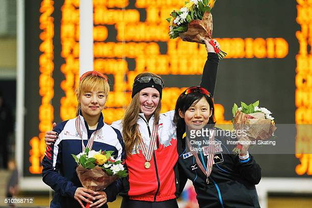 BoReum Kim of Korea Ivanie Blondin of Canada and Miho Takagi of Japan pose with their silver gold and bronze medals during a victory ceremony for the...
