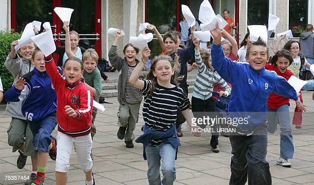 Children from the Borgsdorf primary school run out of their class rooms cheering after receiving their endofterm exam results 11 July 2007 in the...