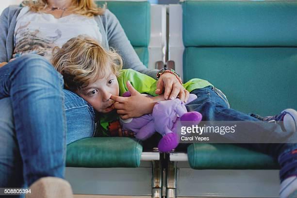 boring boy waiting in airport