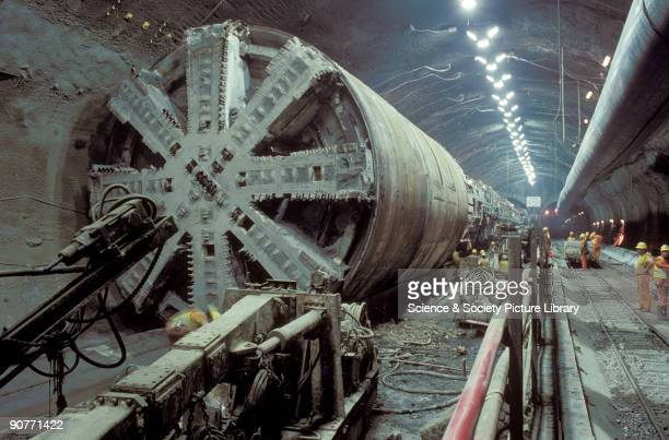 Boring machine used to carve out rock to construct the Channel Tunnel by Chris Hogg 1992 The Channel Tunnel opened in 1995 to create a rail link...