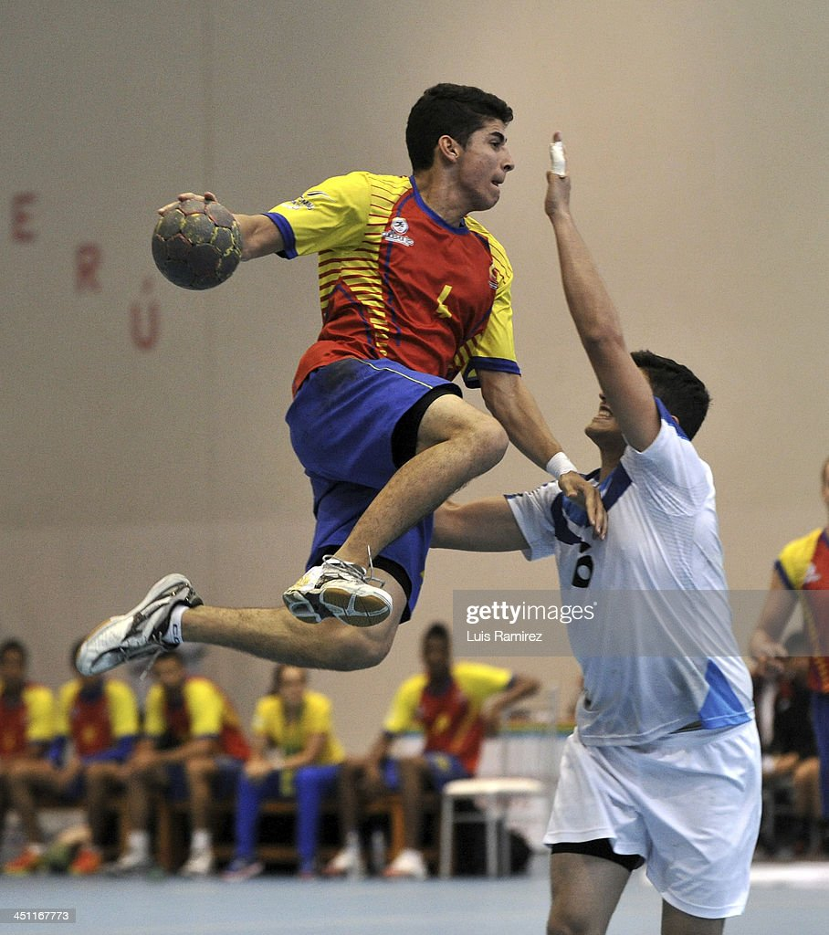 Boris Acevedo of Guatemala fights for the ball with David Cardona of Colombia during a handball match between Guatemala and Colombia as part of the XVII Bolivarian Games Trujillo 2013 at Coliseo Colegio San Agustin on November 21, 2013 in Chiclayo, Peru.