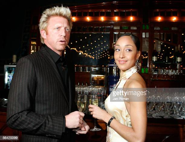 Boris Becker and his girlfriend Caroline Rocher stand at the bar at the Laureus Media Award on December 12 2005 in Munich Germany For the first time...