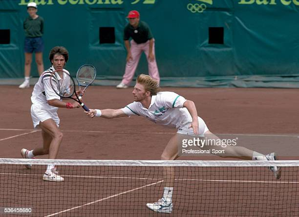 Boris Becker and Michael Stich of Germany competing in the men's doubles during the Olympic Games tennis competition held at Tennis de la Vall...