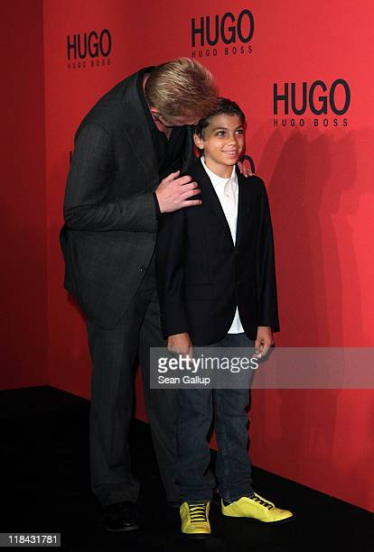 Boris Becker and son Elias attend the Hugo Show during MercedesBenz Fashion Week Berlin Spring/Summer 2012 at the Forum Museumsinsel on July 7 2011...