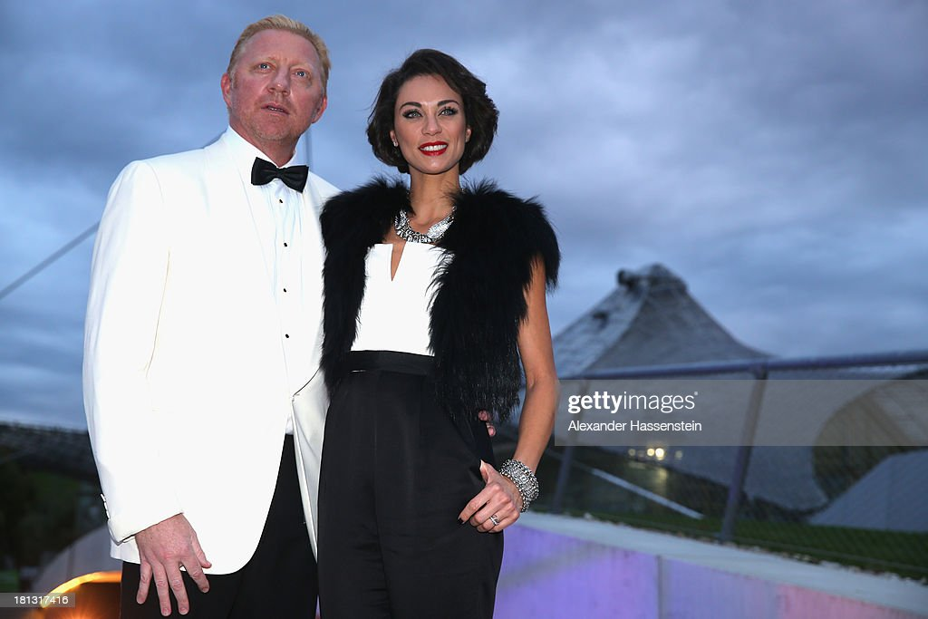 Boris Becker arrives with Sharley 'Lilly' Becker for the Laureus Sport for Good Night 2013 at Munich Olympiahalle on September 20, 2013 in Munich, Germany.