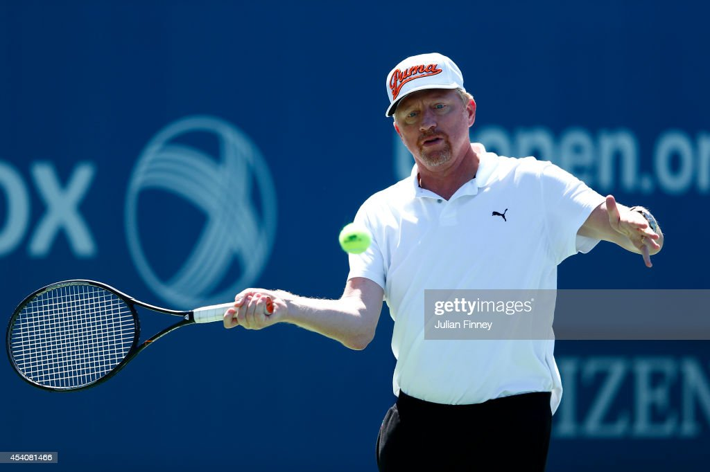 <a gi-track='captionPersonalityLinkClicked' href=/galleries/search?phrase=Boris+Becker&family=editorial&specificpeople=67204 ng-click='$event.stopPropagation()'>Boris Becker</a>, coach of Novak Djokovic has a hit during previews for the US Open tennis at USTA Billie Jean King National Tennis Center on August 24, 2014 in New York City.