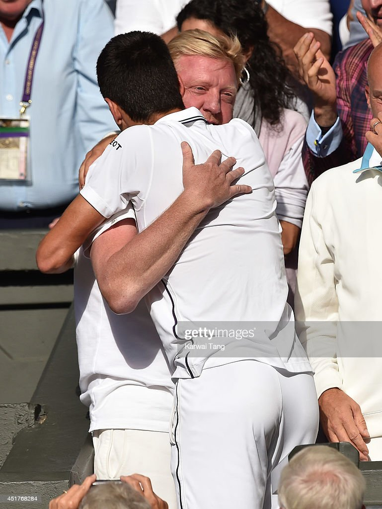 <a gi-track='captionPersonalityLinkClicked' href=/galleries/search?phrase=Boris+Becker&family=editorial&specificpeople=67204 ng-click='$event.stopPropagation()'>Boris Becker</a> congratulates <a gi-track='captionPersonalityLinkClicked' href=/galleries/search?phrase=Novak+Djokovic&family=editorial&specificpeople=588315 ng-click='$event.stopPropagation()'>Novak Djokovic</a> after beating Roger Federer during the mens singles final at the Wimbledon Championships at Wimbledon on July 6, 2014 in London, England.