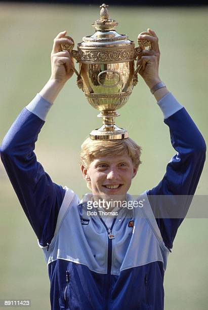 Boris Becker of Germany holding the trophy after winning the men's singles final of the Wimbledon Lawn Tennis Championships held at the All England...