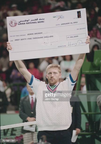 Boris Becker of Germany holds the winning cheque after defeating Goran Ivanisevic in the Men's Singles Final of the Mannai Cadillac Qatar Tennis Open...