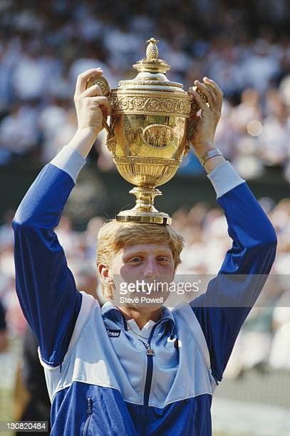 Boris Becker of Germany places the trophy on his head in to celebrate his defeat of Kevin Curren 63 67 76 64 during the Men's Singles final of the...