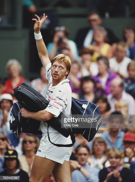 Boris Becker of Germany waves farewell to the crowd after his defeat by Andre Agassi during their Quarter Final match of the Wimbledon Lawn Tennis...