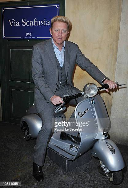 Boris Becker poses on a typical Italian Vespa during the IWC launch of the Portofino watch range at the SIHH International Fine Watch makers...
