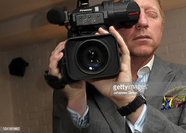 Boris Becker poses with a TV camera ahead of presenting the relaunch of BorisBeckerTV at Kaefer restaurant on September 16 2010 in Munich Germany