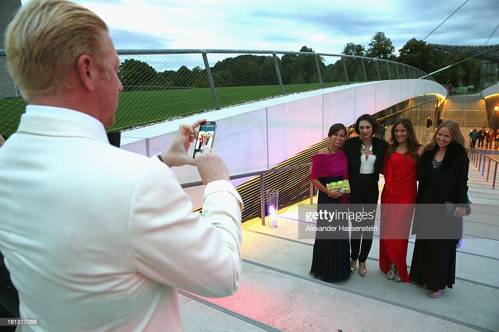 Boris Becker takes private pictures of his wife Sharley 'Lilli' Becker (2nd L) and Simone Ballack (2nd R) as they arrives for the Laureus Sport for Good Night 2013 at Munich Olympiahalle on September 20, 2013 in Munich, Germany.