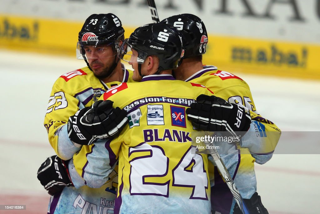 Boris Blank (front) of Krefeld celebrates his team's first goal with team mates during the DEL match between Adler Mannheim and Krefeld Pinguine at SAP-Arena on October 12, 2012 in Mannheim, Germany.